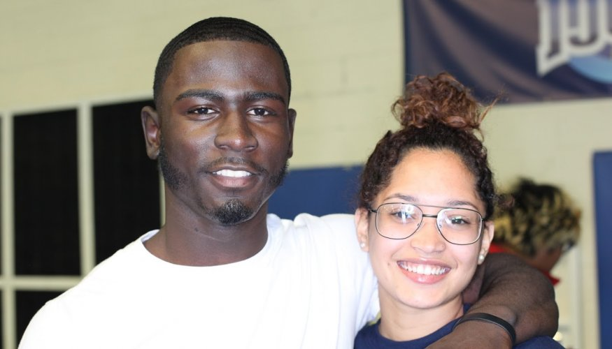 Emanuel Gray and Shelitza Ortiz enjoy the festive atmosphere at the Athletic Center.