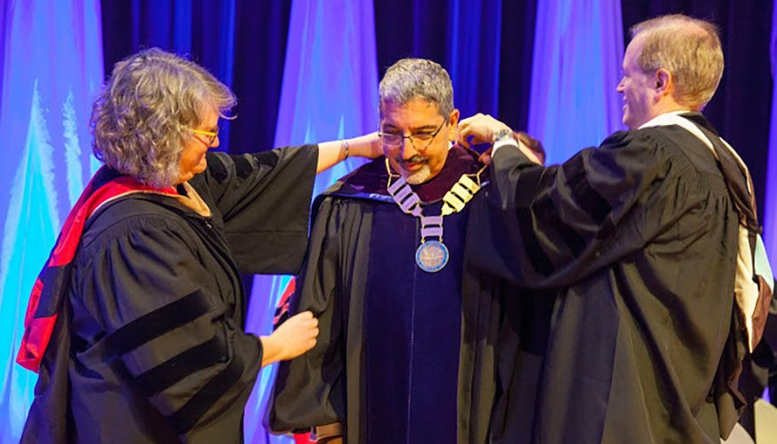 Massachusetts Secretary of Education Jim Peyser and QCC Board of Trustees Chairperson Susan Mailman assist Dr. Luis G. Pedraja with the medal he received at his inauguration. He was installed as the sixth president of Quinsigamond Community College on April 13.