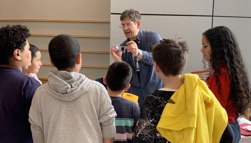 Professor Jacob Longacre demonstrates photnics at the Avanza STEM Expo