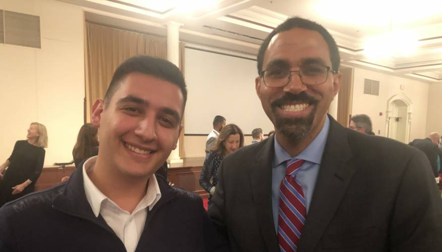 QCC student Jorogo Gushi with former U.S. Secretary of Education John King Jr.