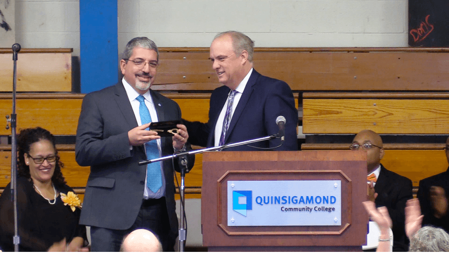 Dr. Luis G. Pedraja receives the key to the City from Worcester Mayor Joseph Petty.
