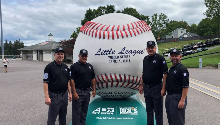 From left: 2021 LLWS umpires David Cofield, Mike Debelak, Brian Henry and Ricci Hall.