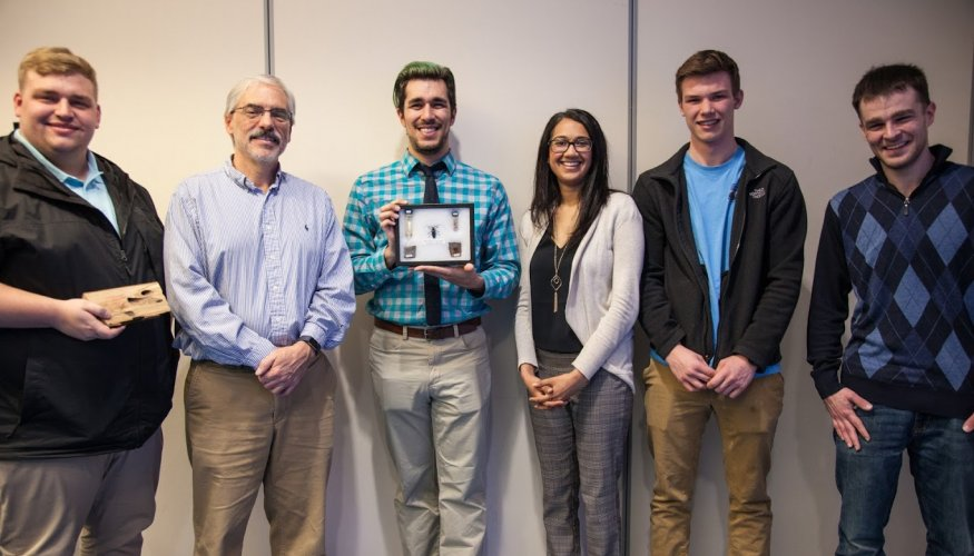Students, faculty and staff learned valuable information about the Asian Longhorned Beetle from ALB Outreach Coordinator Joshua Brucker (center).