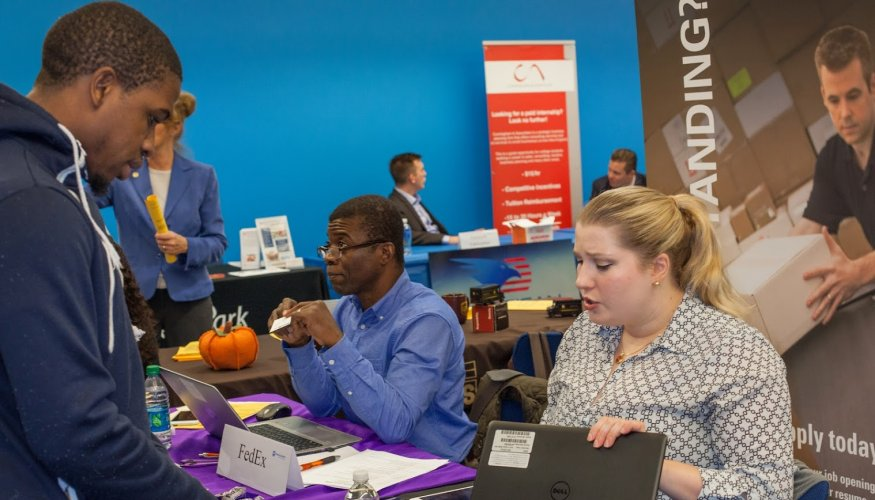 QCC student Chad Jackson discussed employment opportunities with Kara Blom of At & T.