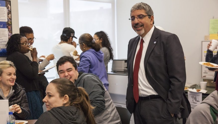 Dr. Luis Pedraja shares some laughs with students at Center for Workforce Development and Continuing Education in downtown Worcester.