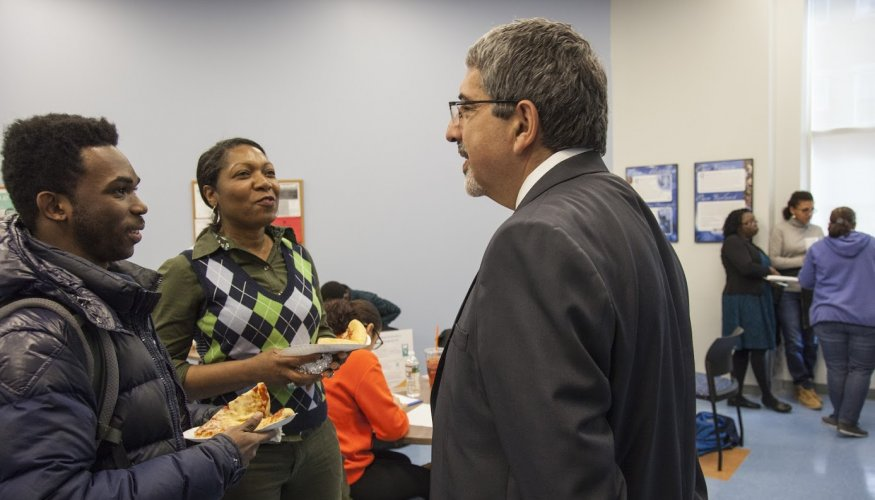 QCC students share their ideas with Dr. Pedraja at QCC's downtown location.