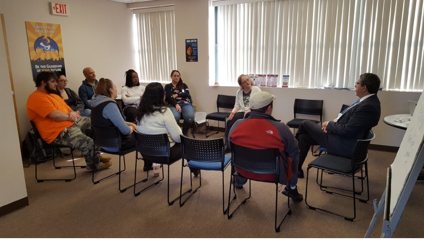 Dr. Pedraja talks with students in Southbridge.