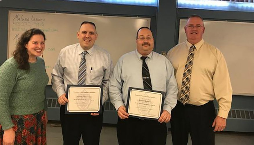 Quinsigamond Community College Deputy Chiefs Reynaldo Rodriguez (center-right) and Stephen DiGiovanni (center-left) successfully completed the Municipal Police Training Committee Instructor Development Course.