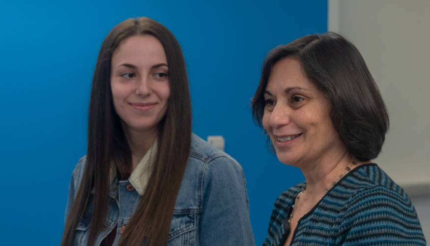 QCC recent alum and past president Katie Berry (left) with Professor Valerie Clemente.