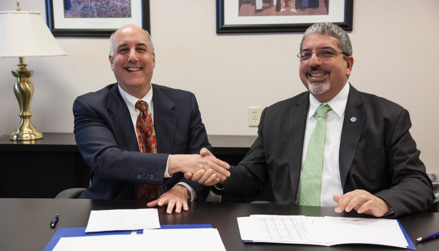 From left: Fitchburg State President Richard S. Lapidus and Quinsigamond Community College President Dr. Luis. G. Pedraja