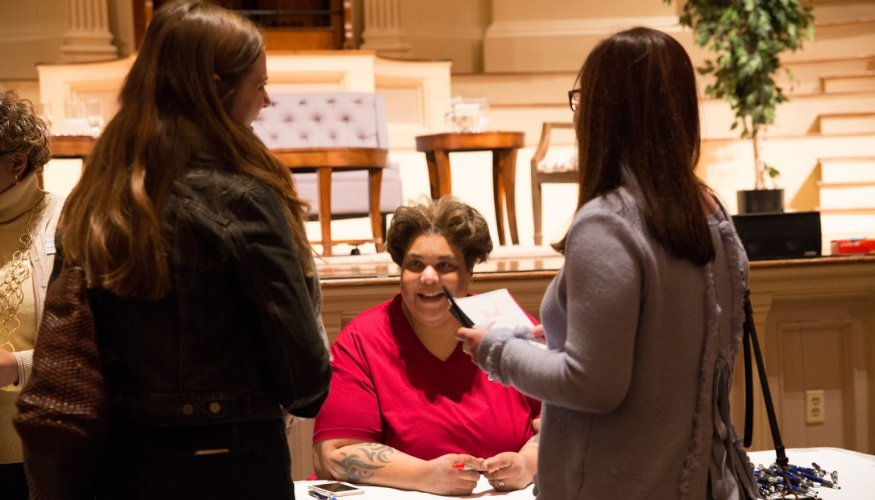 Roxane Gay signs books after her talk.