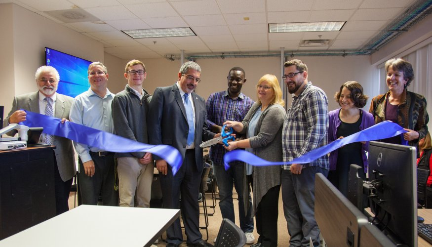From left: Assistant Vice President of Extended Campus Operations & Community Engagement, Victor Somma Jr.; CSET instructor Luis Carmine; QCC student Shawn Coltran; President Dr. Luis Pedraja; QCC student Edris Ebouel; Professor of Computer Systems Engineering Technology, Betty Lauer; CSET Lab Manager, Paul Sluckis; Science Lab Manager, Tracy Levin, and Dean of Business, Engineering and Technology, Kathy Rentsch.