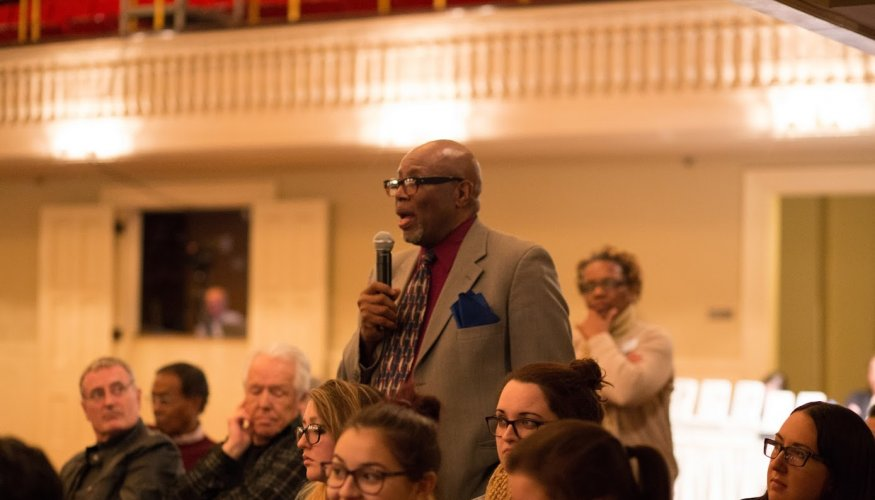 QCC Professor Jerry Williams asks Ms. Gay a question.