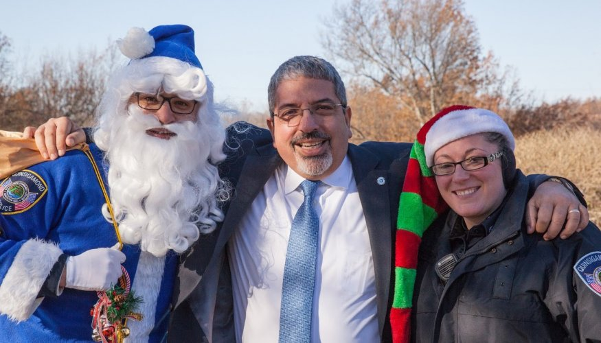 From left: Sargent Joseph Cecchi, QCC President Dr. Luis Pedraja and Officer Catherine Dixon at the Stuff-A-Cruiser event on the college's main campus.