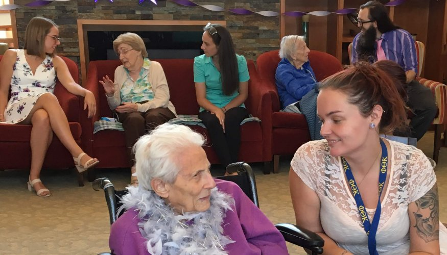 PTK President Jen Brevik (front right) gets to know one of the residents at Oasis at Dodge Park.