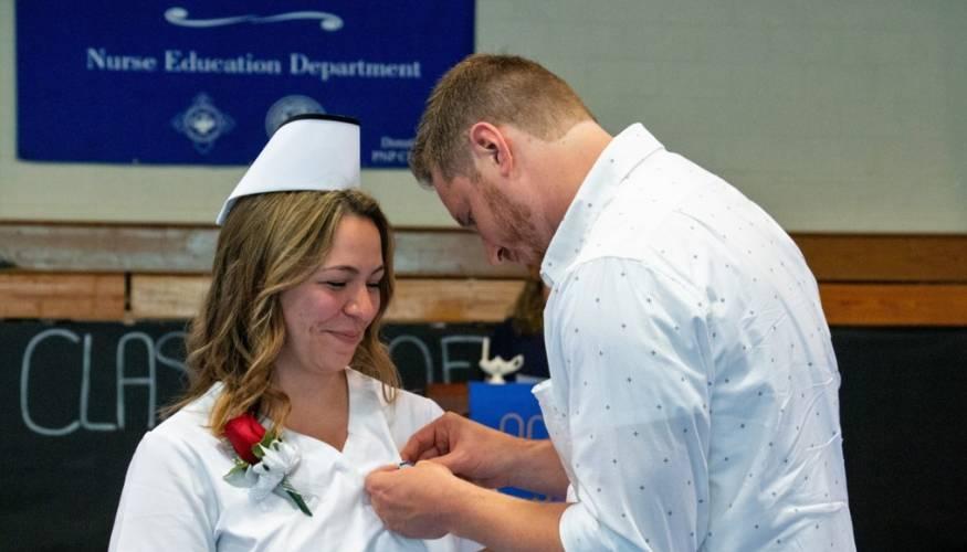 Nursing graduate Cassara Casey is all smiles at her pinning ceremony.