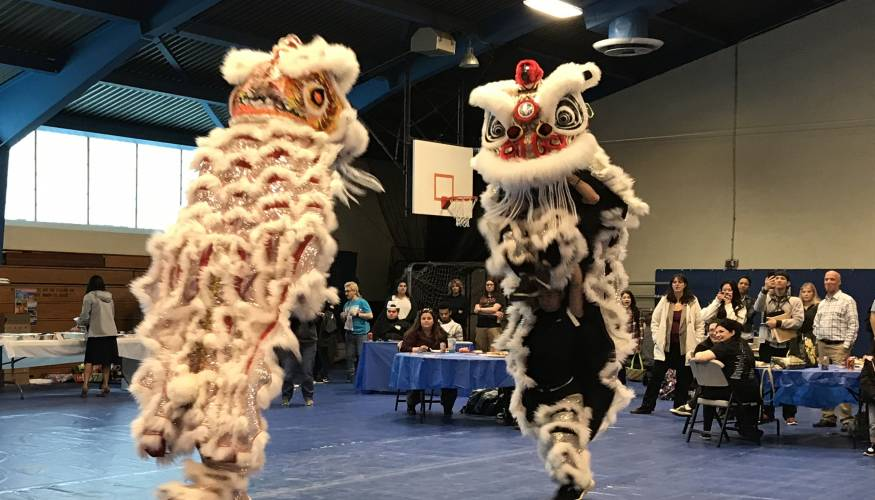The South East Asian Coalition Imperial Lion Dance Team who performed a dragon dance to the beat of drums.