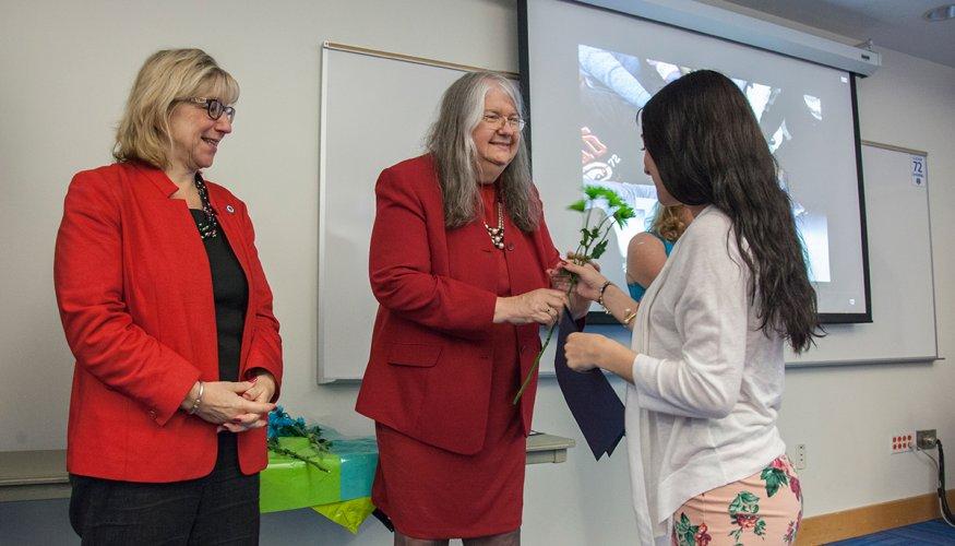 Gail presents award at TRAIN Program event