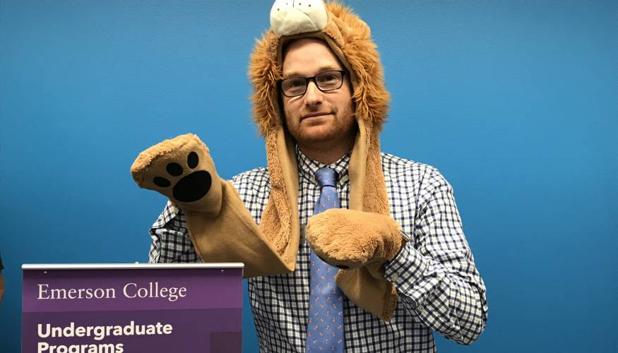 Emerson College Assistant Director Nicholas Washburn gets into the spirit of the QCC Transfer Fair held on Halloween.