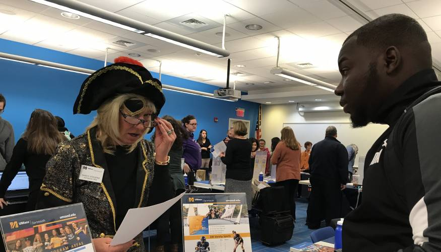 Four Year college and university staff had a bit of fun during QCC's bi-annual Transfer Fair.