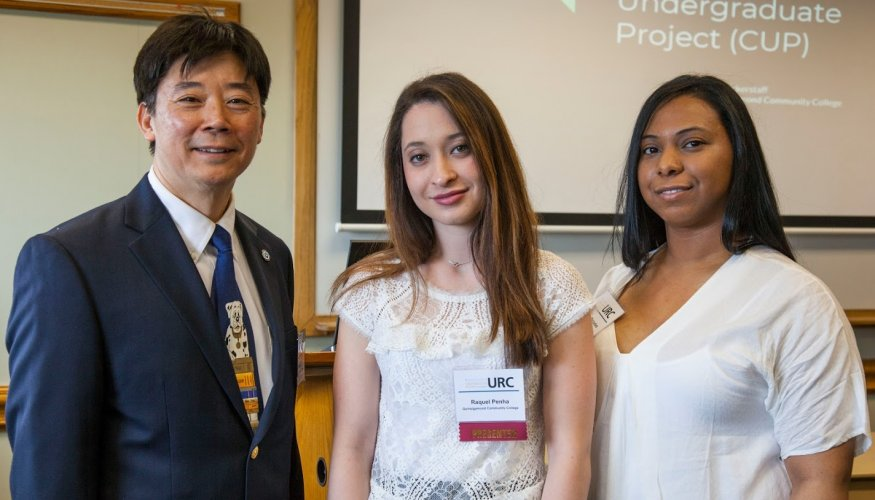 From left: QCC Professor Hao Loi and student presenters Raquel Penha and Yesenia Mercedes.