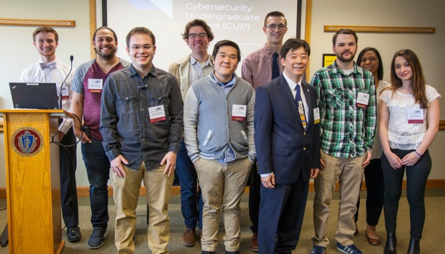 Computer Science Professor Hao Loi with his students who presented at the Undergraduate Research Conference.