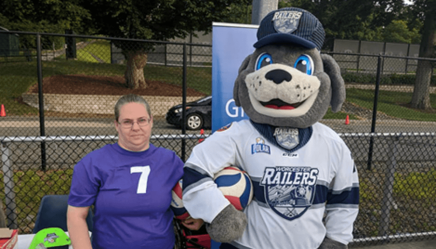 "QCC New Women's Volleyball Coach Emily Boutilette with ""Trax"" of the Worcester Railers."
