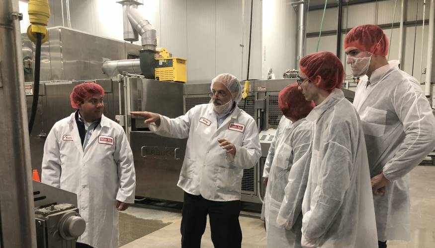 QCC students learn about food manufacturing during a visit to Table Talk Pies.