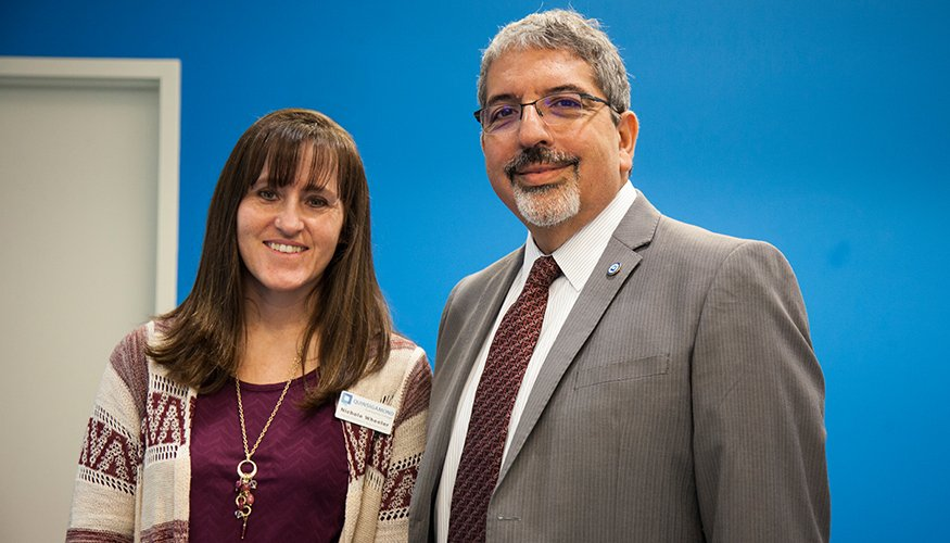 QCC Career Placement Representative Nichole Wheeler and QCC President Dr. Luis. G. Pedraja