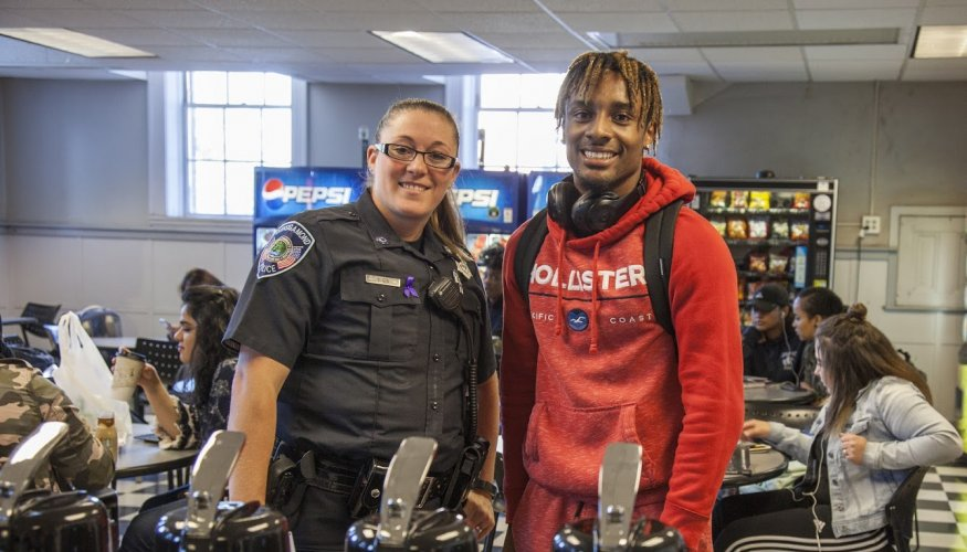Officer Dixon was seen speaking with many students in the cafeteria.