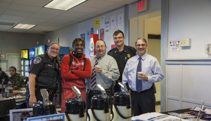Chief Ritacco (far right) along with QCC officers and students enjoy coffee and friendly conversation.