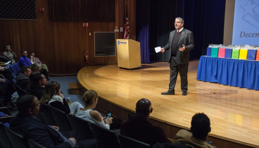 QCC President Dr. Luis Pedraja addresses QCC's the inaugural group of Rising Stars of QCC honorees.