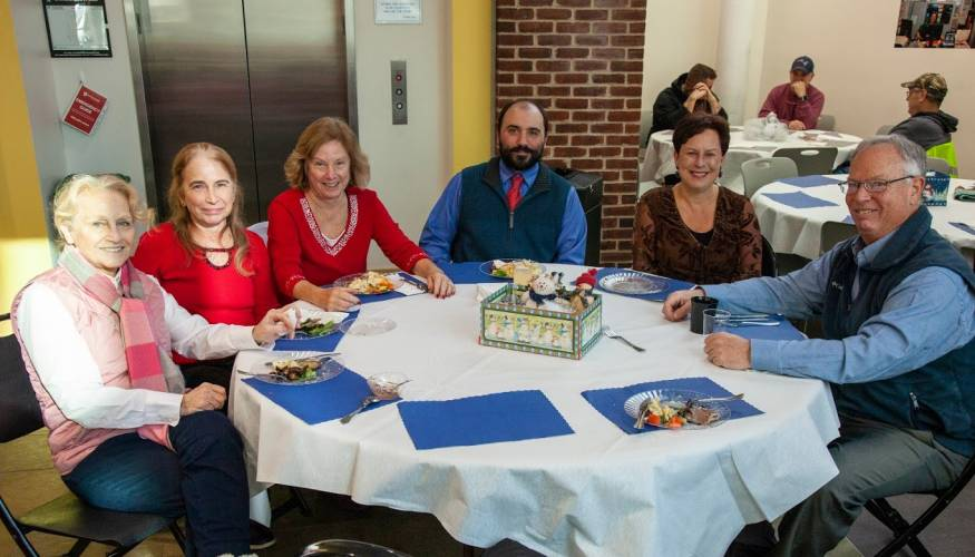 Faculty and staff enjoy the holiday luncheon.