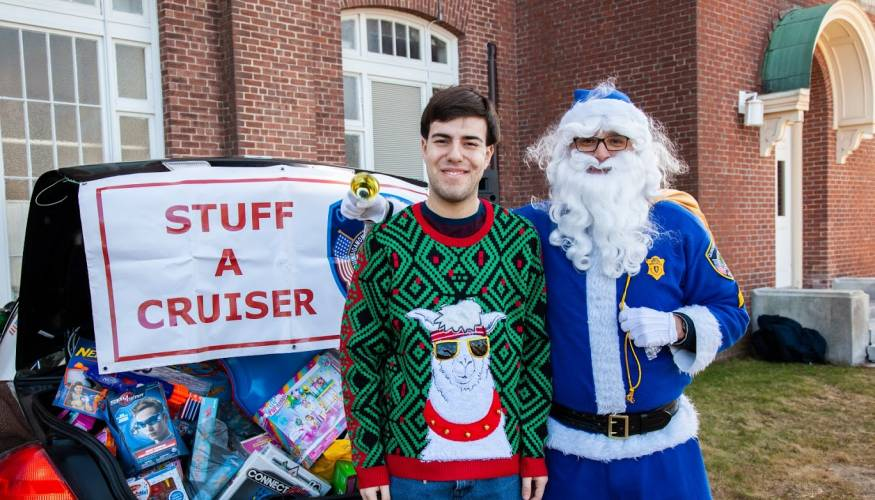 QCC student George Baraklilis and Blue Santa