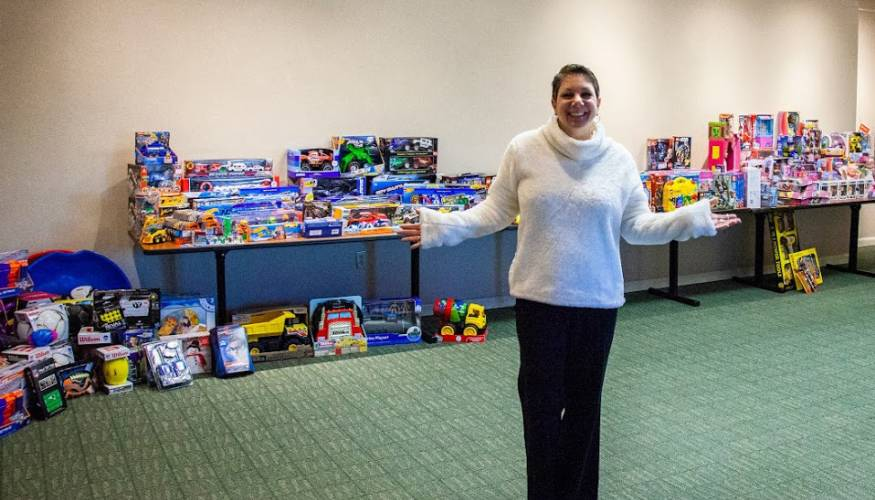 Director of Counseling and Wellness, Tina Wells stands with donations from the Stuff-A-Cruiser event.