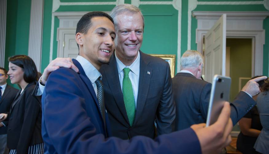 Student Trustee Mustafa Boweden takes a selfie with Massachusetts Governor Charlie Baker.