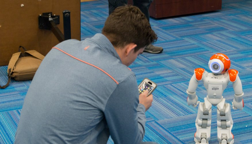 A student tries his had at operating a robot.