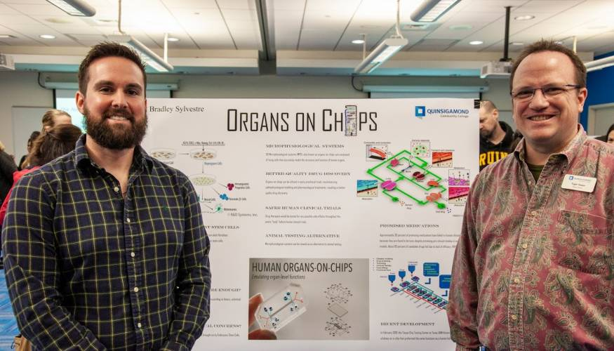 QCC student Bradley Sylvestre explains his project, Organs On Chips, to Coordinator of Library Reference Tiger Swan