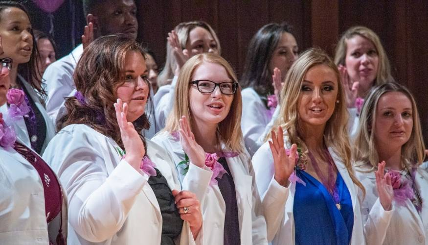 Dental hygiene and dental assistants state their oath.