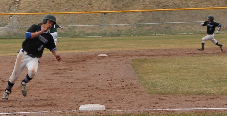 Misael Guzman rounds the base with Hunter Guinto following closely on his heels.