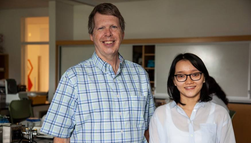 Interim Dean of the School of Math and Science Dr. Benjamin Benton and QCC student and lab support assistant Thi Tran