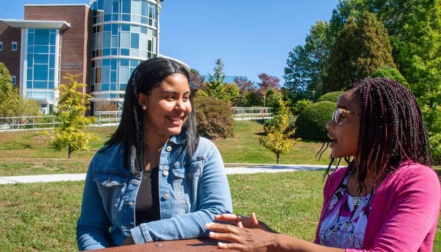 Student mentee Zuheyry Encarnacion shares a laugh with her mentor, Dr. Natalie Anumba.