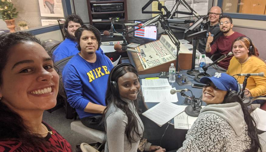 Gilmarie Vongphakdy's (left) Mass Communication students record 'A Christmas Carol' at Audio Journal Studio.