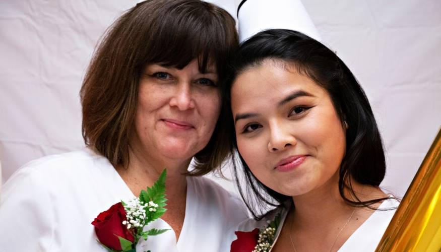QCC Nursing graduates from the day program (from left) Suzanne Phipps and Kim Nguyen.