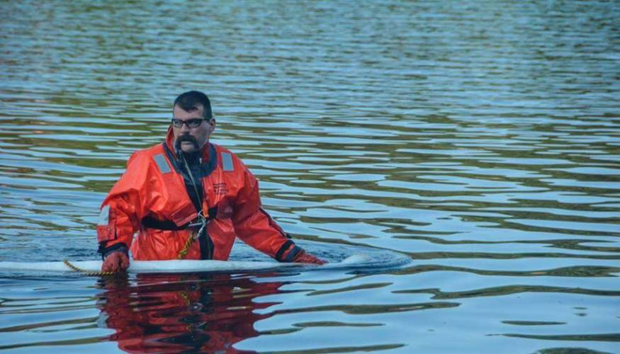 Sutton Fire Department District Fire Chief Robin Dresser during a boat rescue.