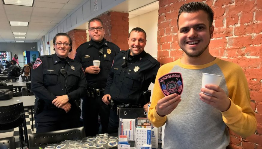 Student Raymond Rodraes shares a coffee with a few QCC Cops.