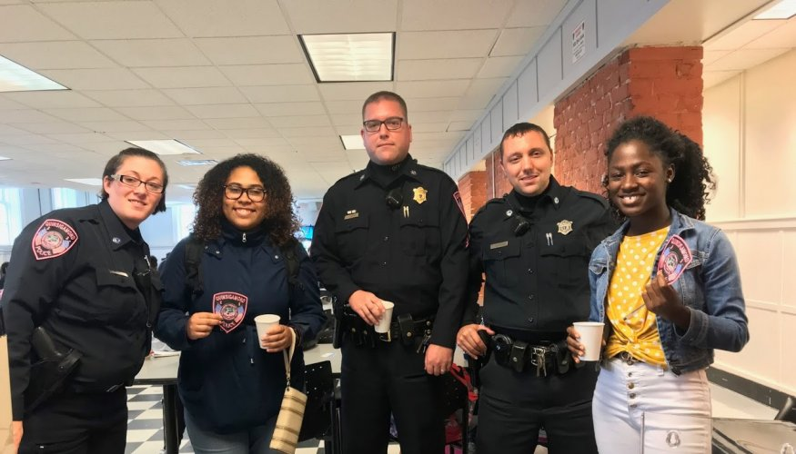 Students enjoy Coffee with a Cop event.