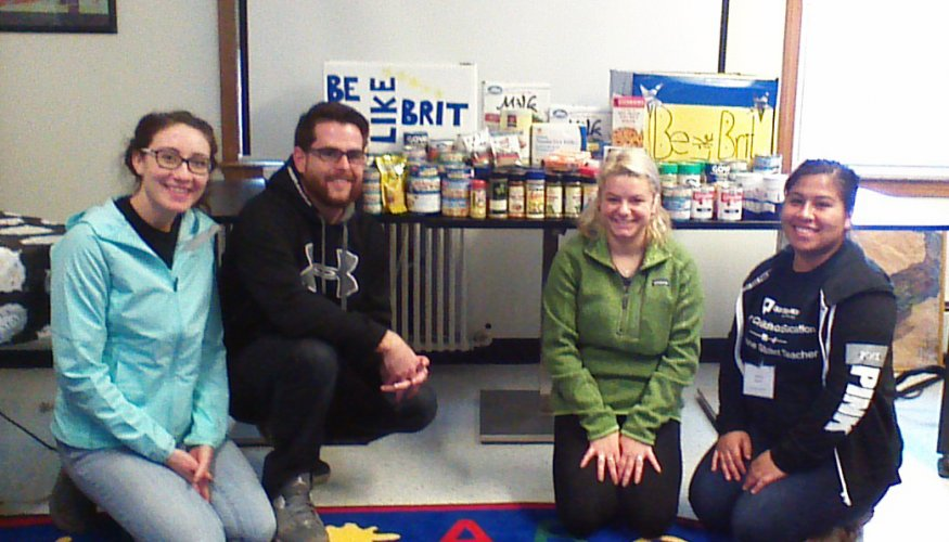 students sit with collected food items