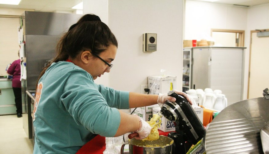 QCC students are a big part of the meal preparation during the school year.