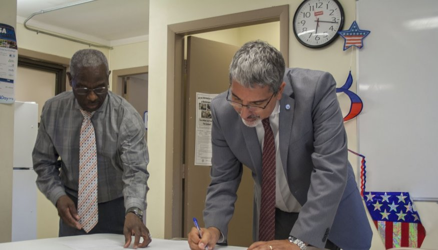 From left: Director of Family & Resident Services at Great Book Valley Carlton Watson and QCC President Dr. Luis Pedraja.
